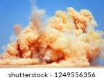 the rock dust clouds after the... | Shutterstock . vector #1249556356