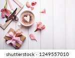 pink eustoma flowers  coffee... | Shutterstock . vector #1249557010