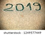 2019 inscription on the glass... | Shutterstock . vector #1249577449