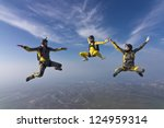 three skydivers doing shape. | Shutterstock . vector #124959314