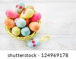 easter eggs in a wicker basket   Shutterstock . vector #124969178