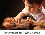 little boy and a tablet computer | Shutterstock . vector #124971986