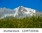 the snow covered peaks of the... | Shutterstock . vector #1249720336