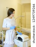 nice cosmetologist in blue... | Shutterstock . vector #1249739266