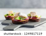Stock photo tradition danish open sandwich smorrebrod with herring egg cucumber and onions dark bread 1249817119