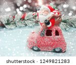 christmas santa on red car with ... | Shutterstock . vector #1249821283