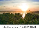 foggy landscape. grass and lake ... | Shutterstock . vector #1249891873