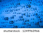 water droplets on blue... | Shutterstock . vector #1249963966