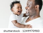 cheerful dad and his baby | Shutterstock . vector #1249970983