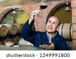 joyful mature male winemaker in ...   Shutterstock . vector #1249991800