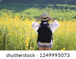 young woman traveler with... | Shutterstock . vector #1249995073