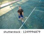 a nice tennis player having fun ... | Shutterstock . vector #1249996879