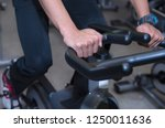 close up man on exercise bike... | Shutterstock . vector #1250011636