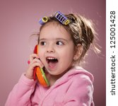 little girl on the phone | Shutterstock . vector #125001428