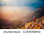 female tourist at the top of...   Shutterstock . vector #1250058853