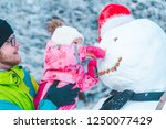 father holding daughter on... | Shutterstock . vector #1250077429