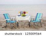 romantic dinner on the sea... | Shutterstock . vector #125009564
