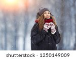 winter young woman portrait.... | Shutterstock . vector #1250149009