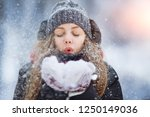 winter young woman portrait.... | Shutterstock . vector #1250149036