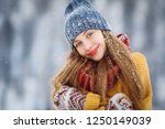 winter young woman portrait.... | Shutterstock . vector #1250149039