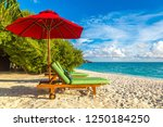wooden sunbed and umbrella on...   Shutterstock . vector #1250184250