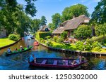 giethoorn  netherlands   july 4 ... | Shutterstock . vector #1250302000