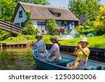 giethoorn  netherlands   july 4 ... | Shutterstock . vector #1250302006