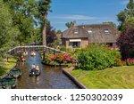 giethoorn  netherlands   july 4 ... | Shutterstock . vector #1250302039