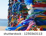 wooden posts covered in ribbons ... | Shutterstock . vector #1250363113