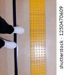 his feet standing in front of... | Shutterstock . vector #1250470609