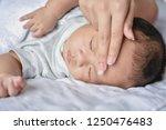 newborn concept. the baby is... | Shutterstock . vector #1250476483
