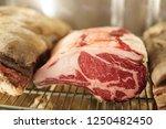 dry aged ribeye steak on... | Shutterstock . vector #1250482450