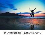 asian woman fun jumping and... | Shutterstock . vector #1250487340