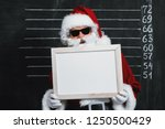 a portrait of santa claus in... | Shutterstock . vector #1250500429