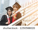 two young asian women students... | Shutterstock . vector #1250588020