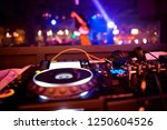 dj mixes the track in the...   Shutterstock . vector #1250604526
