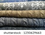 stack of knitted sweaters with... | Shutterstock . vector #1250629663
