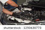 professional mechanic checking... | Shutterstock . vector #1250630773