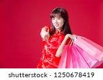 beauty woman wear cheongsam... | Shutterstock . vector #1250678419