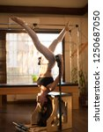 peak pilates   young woman... | Shutterstock . vector #1250687050