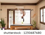 peak pilates   young woman... | Shutterstock . vector #1250687680
