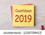 countdown 2019 written on note... | Shutterstock . vector #1250708413