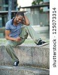 handsome young african american ... | Shutterstock . vector #125073314