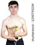 Successful caucasian young adult swimmer isolated on white background with award - stock photo