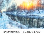 Winter Landscape By A River In...