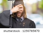 young handsome graduated man... | Shutterstock . vector #1250785870