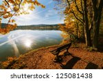 Stock photo sitting by a lake in autumn colors 125081438