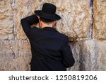 praying at the wall in... | Shutterstock . vector #1250819206