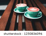 two cups of living coral...   Shutterstock . vector #1250836096