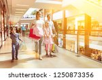 family shopping with two... | Shutterstock . vector #1250873356